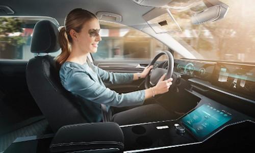 Woman driving car.
